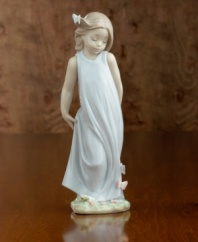 A little girl in a flowing gown crowned with a butterlfy in her hair and on her dress. Porcelain. Measures 8.5 x 3.25.