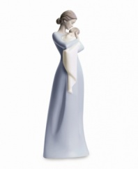 There's simply nothing on earth like a mother's embrace. Beautifully evoking the sweet simplicity of this unparalleled experience, this figurine is delicately crafted in fine porcelain with simple painted hues and a high gloss finish. Measures 12.5 x 4.