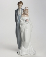 This shining bride and groom figurine make a sweet wedding or anniversary gift for your favorite couple.