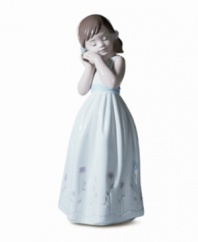 Let your favorite little girl know she's a true princess in your eyes! This simply pretty figurine makes a wonderful gift. Crafted of fine porcelain with delicate painted hues and a high-gloss finish. Measures 7.25 x 3.25.