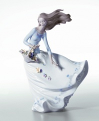 The dynamic movement of this handcrafted piece brings beauty to your home. The perfect gift or addition to your own decor, this porcelain figurine celebrates the splendor of flower petals floating in the wind. Measures 11.25 x 8.