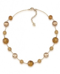Golden rules. Gold-hued glass pearls are complemented by alluring amber-colored fireball accents on Carolee's chic illusion necklace. Made in gold tone mixed metal, it will add polish to your workday wardrobe. Approximate length: 16 inches + 2-inch extender.