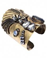 Give your look a little cuff love. Bar III's head-turning cuff bracelet features an intricate design accented by clear and blue acrylic stones in a variety of shapes and sizes. Crafted in burnished gold tone mixed metal. Approximate diameter: 2-1/3 inches.