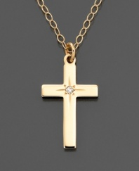 A lovely and meaningful gift, this 14k gold dainty cross pendant features a pretty diamond accent.
